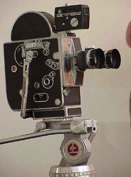 Bolex camera on 1st head of 2nd tripod